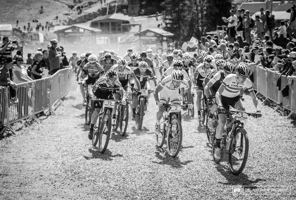 Dan McConnell gets away clean on the men's start with Schurter hot on his heels.