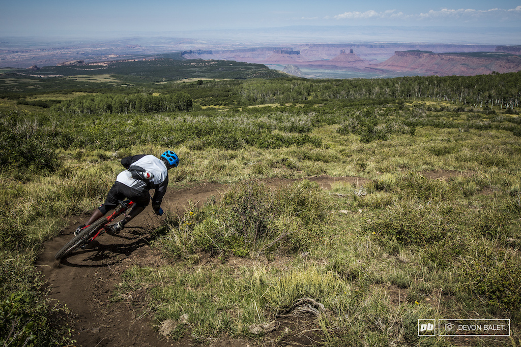 Matt Terry ripping one of the opening turns on Hazard Pass with Castle Valley as a perfect backdrop.