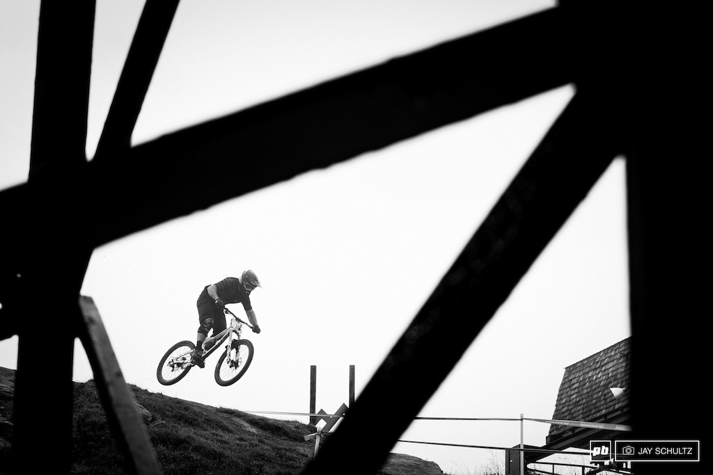 Tower Abstract - A unique perspective through the lift tower on the top of the course. Phil Kmetz gets some air over the rock just out of the start gate.