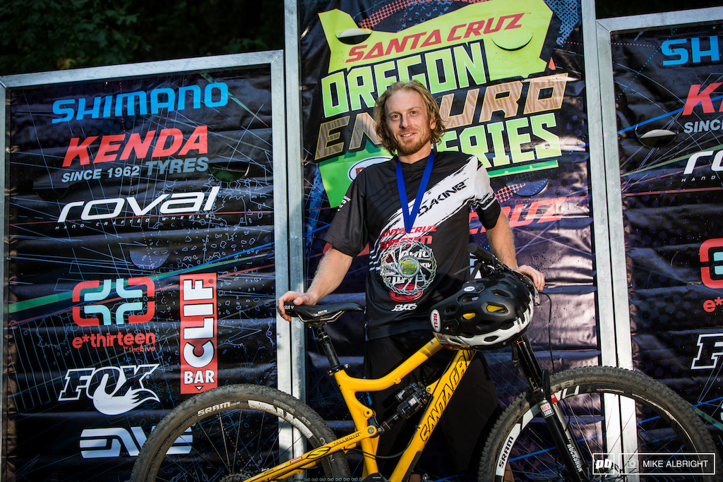 Pro Men winner Nathan Riddle with his Santa Cruz Tallboy LT