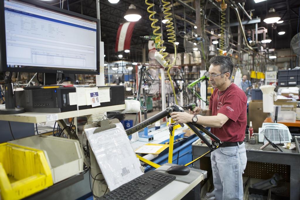 Antonio Cortez works on assembling Trek P1 custom bikes in Whitewater WI USA.