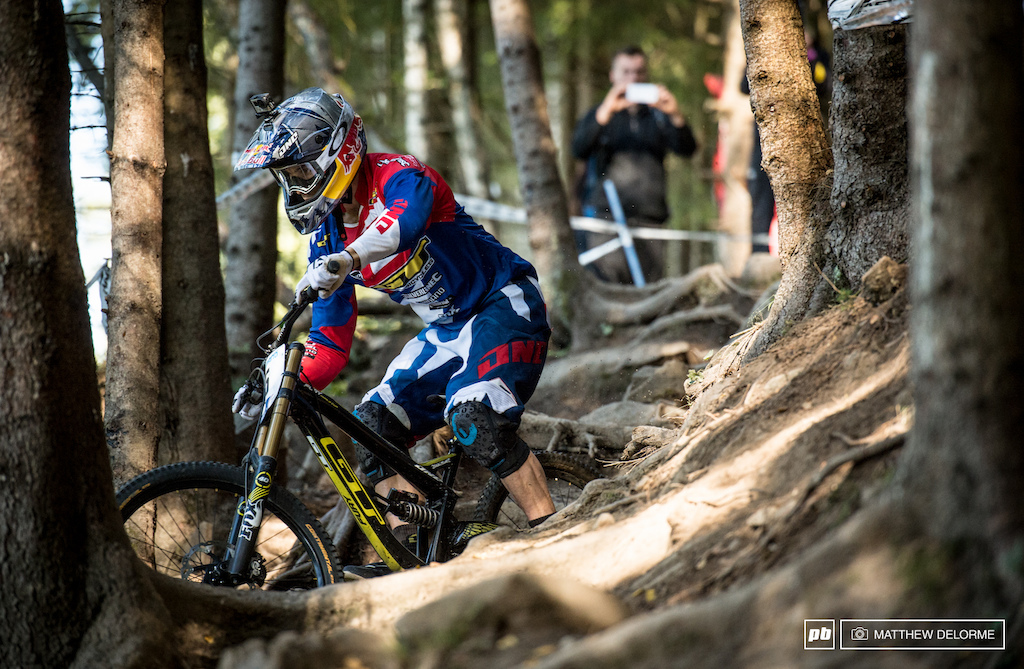 Gee Atherton is finding speed and consistency on the slower safer line out of the rock garden. It s all about risk versus reward here.