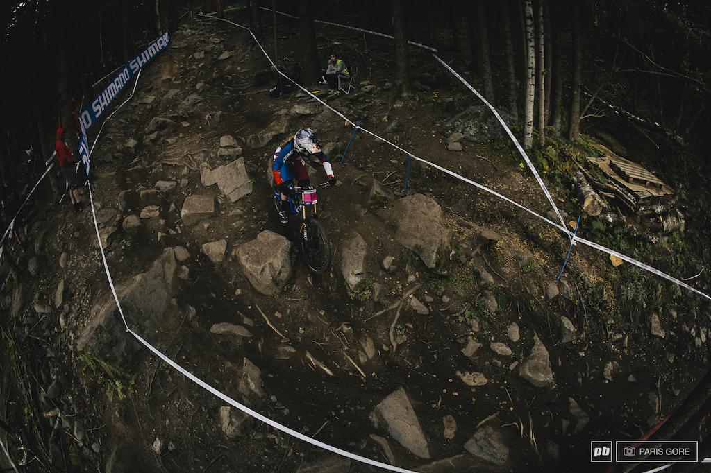 Rachel Atherton weaving through the multiple rock garden lines.