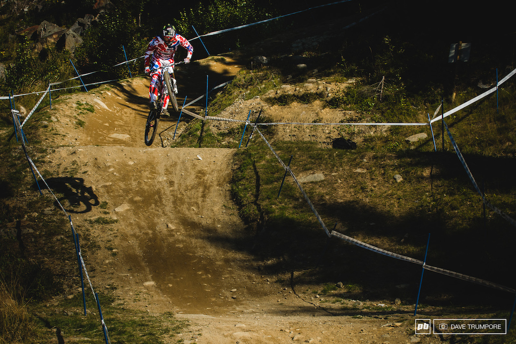 Rat Boy grabs a handful and sends it off the massive road gap up top. He is one of the few landing well down the hill where most are ever so slightly casing it.