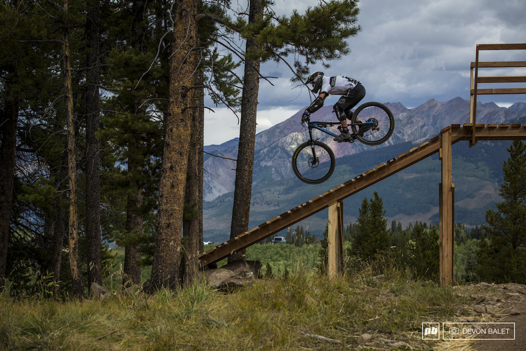 An unknown racer floats into the opening of Avery Trail.