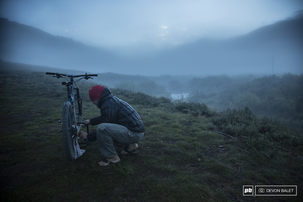 Photographer Eddie Clark prepares his bike for another day of abuse while out on course.