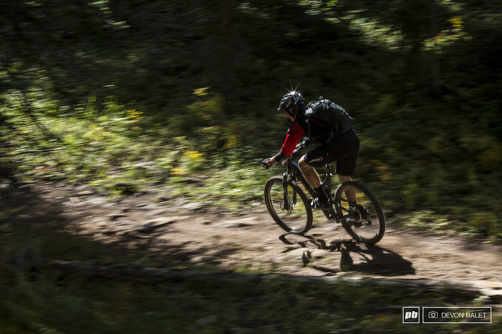 An unknown racer blurs into the dark forest of Green Lake Trail.