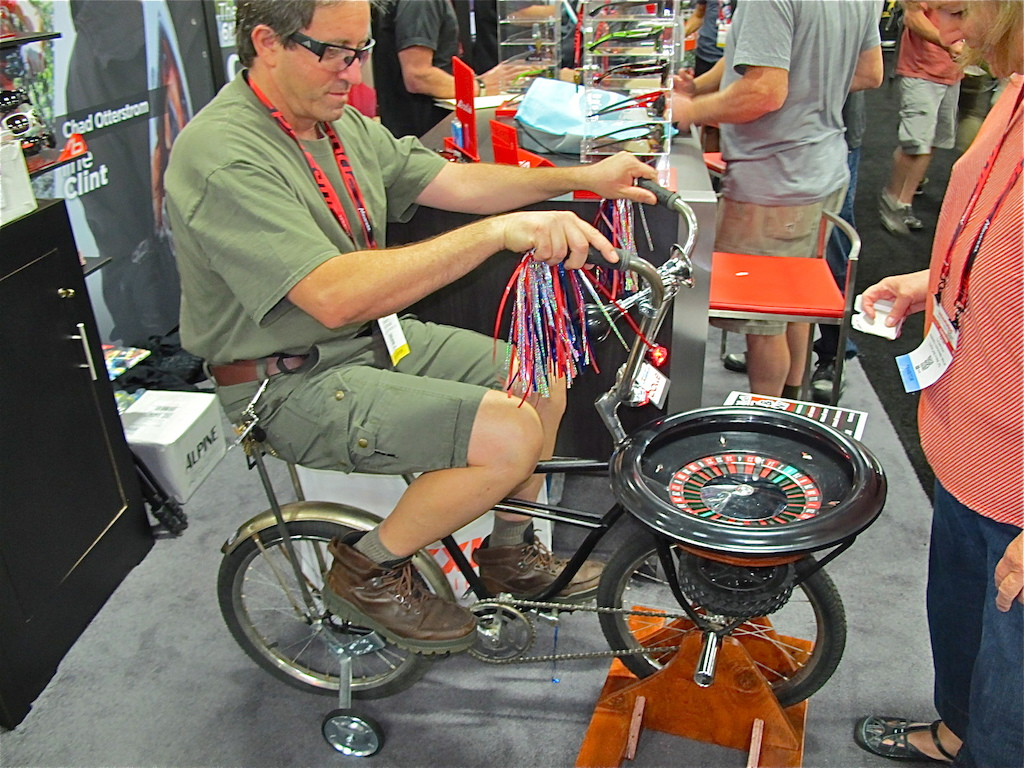 Everyone is a winner in Vegas. Check out this cool bike the Bolle had set up at their booth called the Sit and Spin - Roulette. Hop on give it a pedal and place your bet You could take home shades shirts hats socks or gloves.