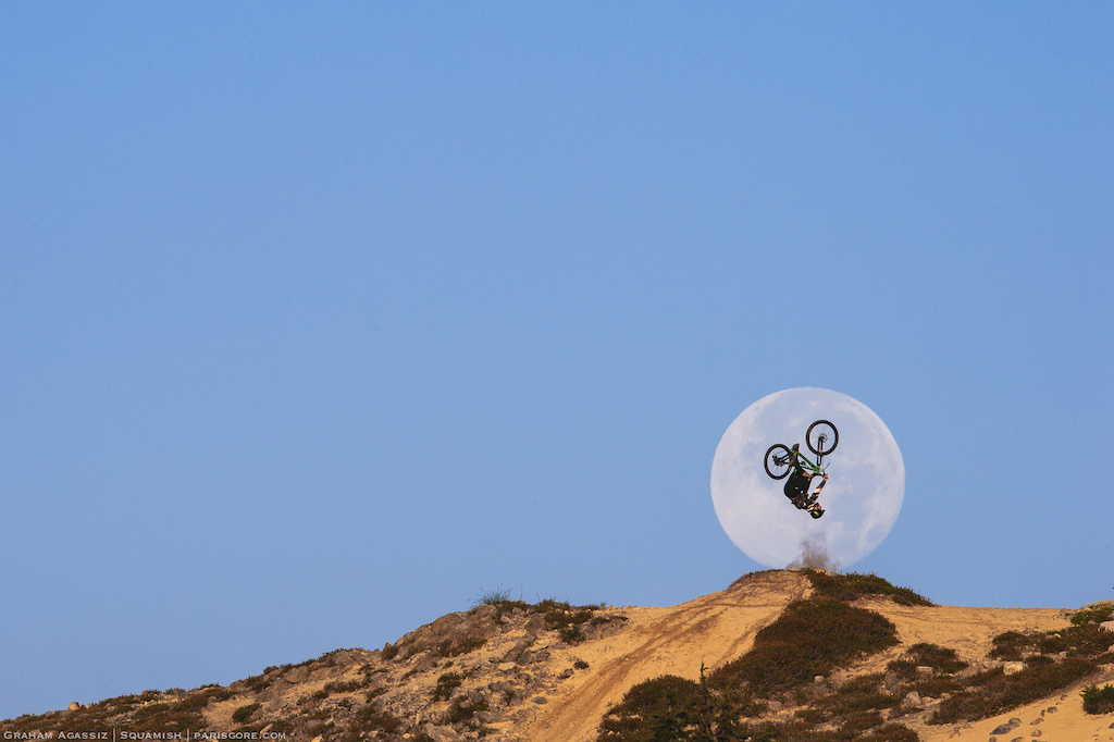Graham Agassiz flipping the August 11th Super Moon during the 2014 Deep Summer Photo Challenge. Shot with a Nikon D4 amp 600mm F4 Lens Processed in Lightroom for basic color correction.