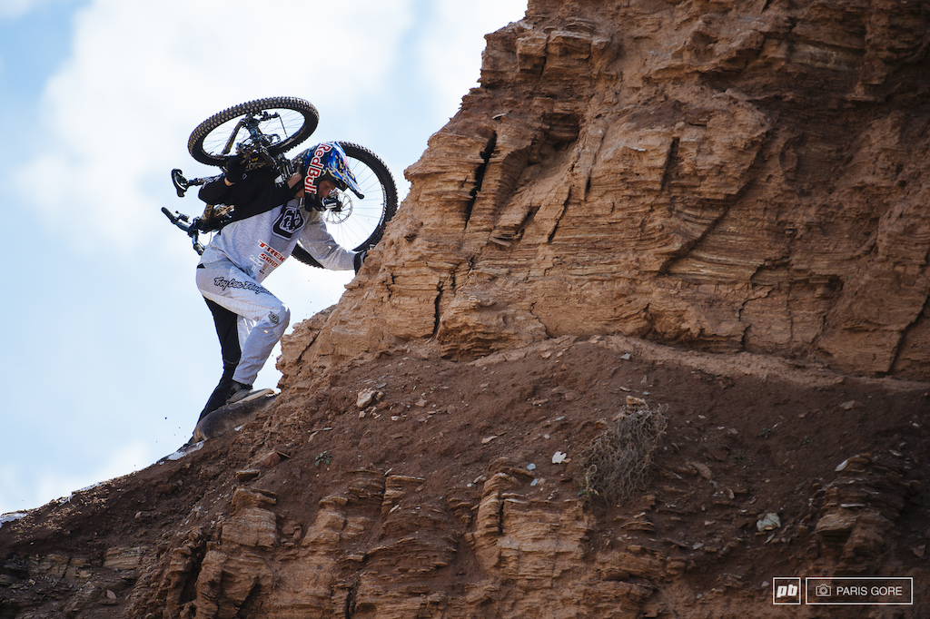Brandon Semenuk hiking up to try out his intro drop.
