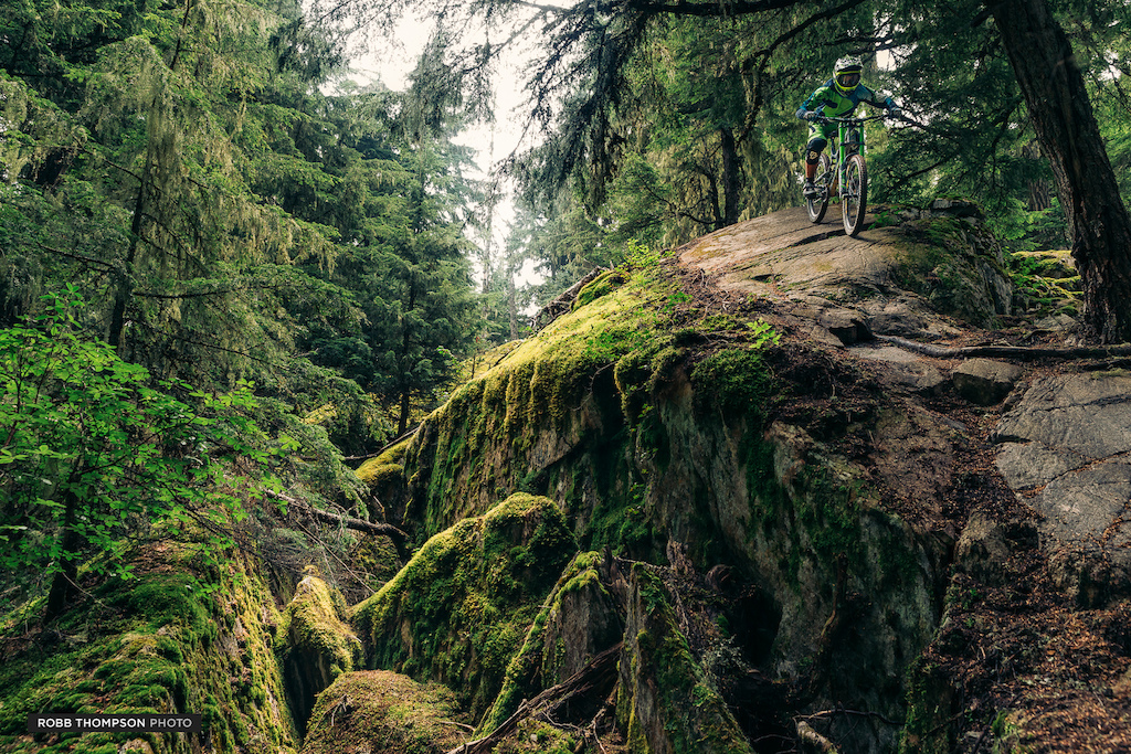 Another favourite from this year, shot in Whistler over Crankworx on a foggy damp day. I just love the richness of the greens and the environment, but it doesn't really do justice to just how slippery and off camber the rock face and roots are. A crash here would have ended badly for Mark.