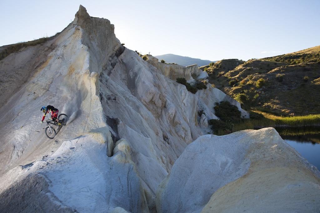 Enduro MTB racer, Kiwi Jamie Nicoll, explores St Bathans during a post-training play riding session, Central Otago, New Zealand.