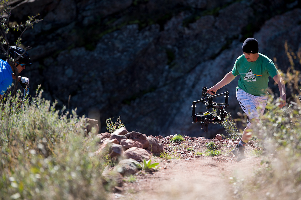 Ryan Goble hand holding the gimble. It takes a special talent to run up a rocky trail while filming the action behind you.