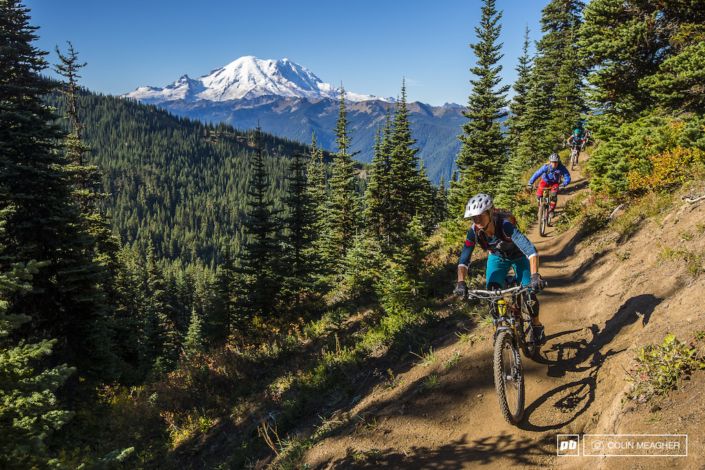 Mount Rainier is the dominant feature on the horizon of every ride on 410... It s simply impossible to ignore. Jenny Konway cruising towards Corral Pass with Nikki Hollatz and Kim Russell.