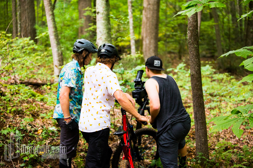 Evan and Brandon check out a clip with Zach in WNC. Photo Derek DiLuzio http www.derekdiluzio.com