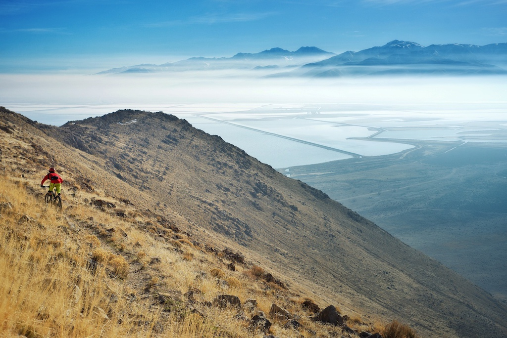 Riding bikes on an island in the middle of the Great Salt Lake has to be one of the most surreal experiences i ve ever had. After a brutal climb you get miles of flowy singletrack with views like this. Not too shabby.