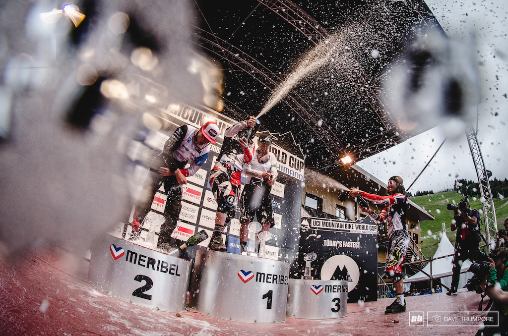 And the winners are... Victory Champagne covers the lens as the 2014 Jr amp Sr World Cup Champions celebrate their overall victories in Meribel. My favorite part of this shot is that as seasoned podium regulars Manon and Josh are spraying away newcomers to the champagne party Tegan amp Loris are fumbling to open or dropping their bottles of bubbly. A few moments later the World Cup season came to a close.