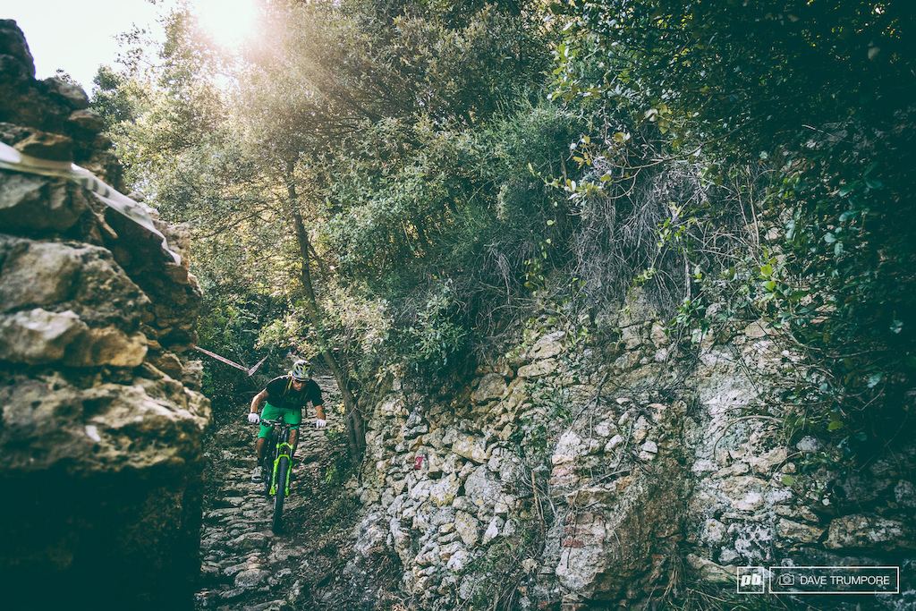 Between the warm waters of the Mediterranean Sea that greeted us at the bottom of each run and a culture in Finale that put an emphasis on living more than simply making a living there was a lot to love about closing out the competitive season in Finale Ligure. But in the end it was the trails that really won me over. From riding past Neolithic Era caves one minute around medieval castles the next or down the remnants of old Roman roads you really were riding through history. In this photo Bryson Martin Jr. threads his way down the thousand year old cobble stone road that makes up the bottom of one of the final EWS stages of the year.