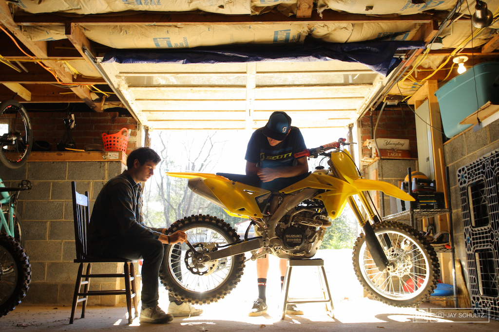Tools of the Training Trade Neko doing some minor adjustments and maintenance on his 2013 Suzuki RM-Z450 before a day at the track in just 24 short hours. If you are a DHer and don t have moto or two in the garage there s something seriously wrong with your training program.......... plus you aren t having any fun.