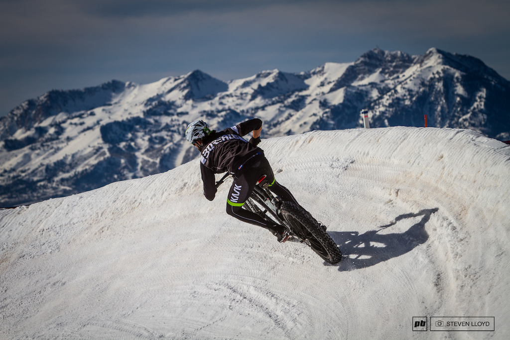 Nat Ross shredding corners with an epic Snowbasin backdrop.
