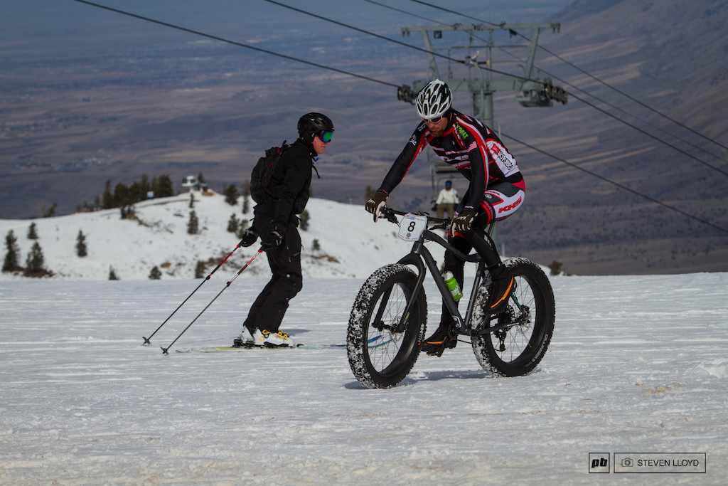 Skiers and bikers shareing the slopes.