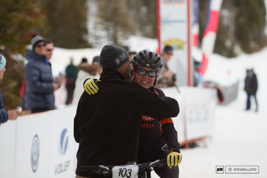 Amanda Miller with a big hug at the finnish line.