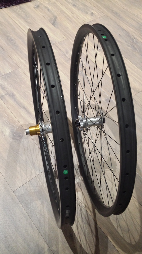 New wheelset - Light bicycle 35mm wide hookless 650b rims (am layup front @397g, dh layup rear @451g), laced to hope pro2 evos (15mm/142mm with xd driver) with dt supercomp spokes + 12mm brass nipples. 1718g all in.