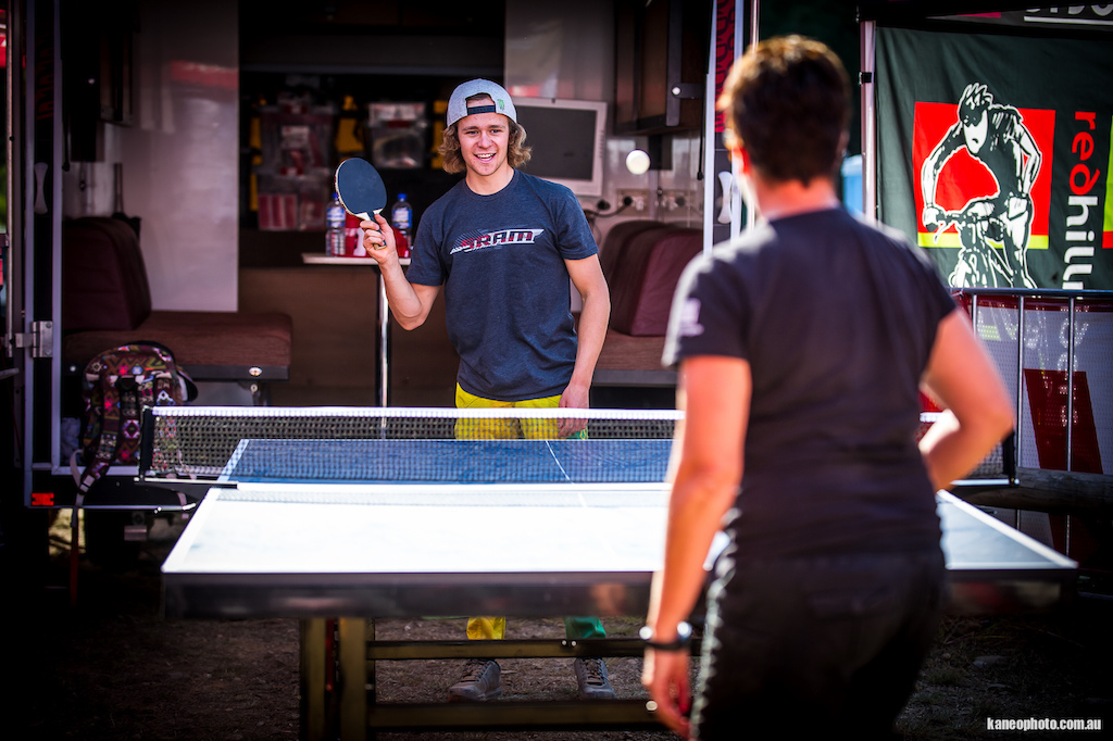 Troy relaxes between runs with his Mum on the ping pong table