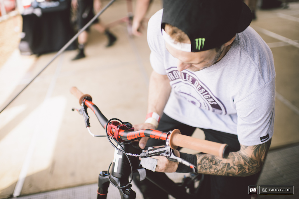 Cam Zink giving his new carbon YT a fresh sticker job. Note the brace around his left hand broken only a week ago and cut the cast off early to ride.