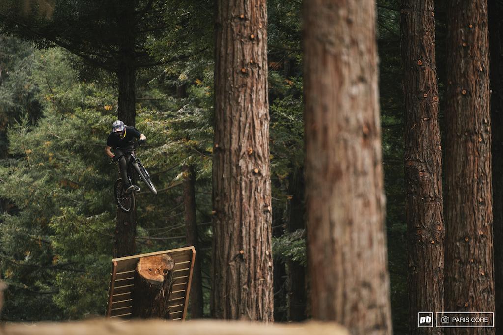 Brandon Semenuk flowing through the woods.