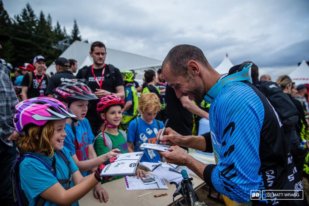 Fabien Barel signs autographs for young fans.