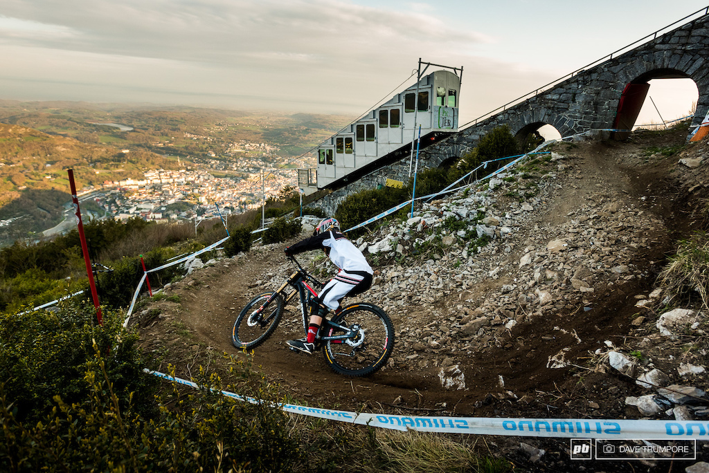 As the Funicular descends to pick up the next group of riders Manon Carpenter gets practice started at a brisk and dark 8am as only the days first rays of light begin to shine of the village of Lourdes below.