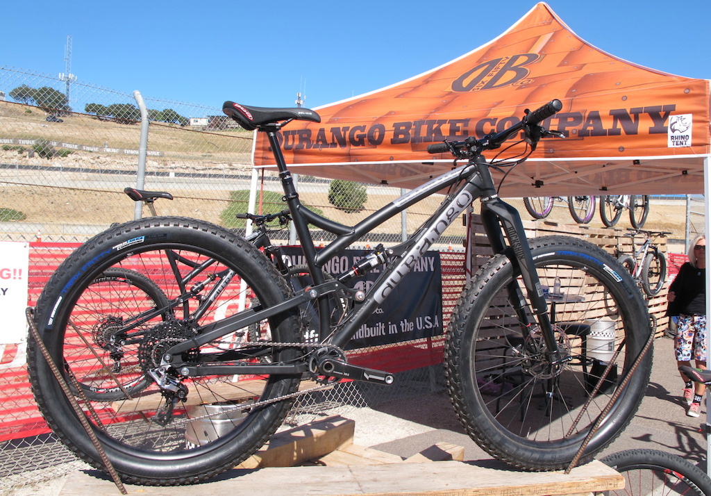 """This is the Black Jack from Durango Bike Company. It's a 29er frame that is currently shod with a 650B + wheel set up. The rear end is set to 120mm of travel via a modified Horst Linkage.  The entire frame is made in the USA, from the tubes, billeting and even the rear axle on the 148mm hub. You'll find over sized Enduro brand bearings at all the pivots too. Add in the 16.7"""" seat stays, 67.5 degree head angle and this bike is made to last and to really get the most out of your trail riding experience."""