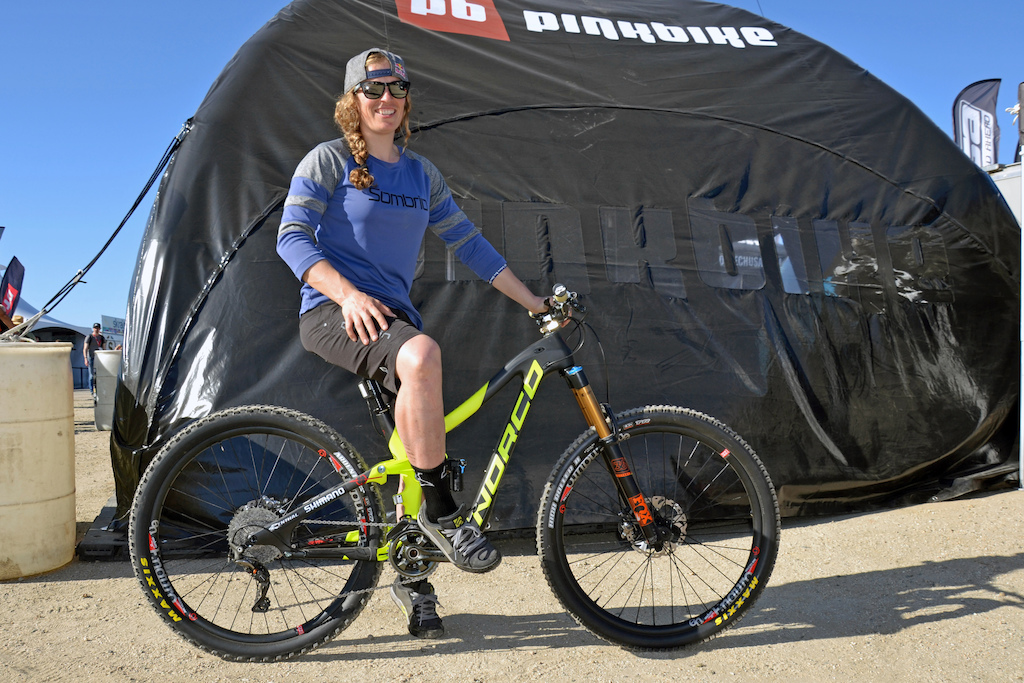 Jill Kintner was cruising by the Pinkbike booth on her official team color Carbon Norco Range.