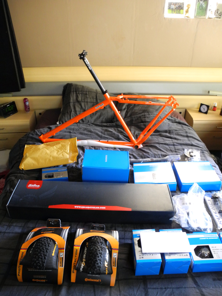 New parts for a full custom On One Inbred 29er. Cheap; SLX, MT66, Salsa steel fork, Ritchey parts... That sassy orange combined with black is really sweet. Can't wait to build it.