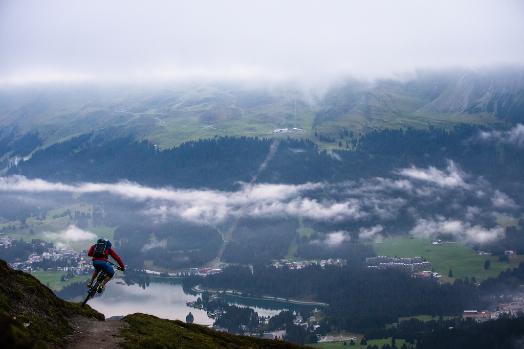 """Above the """"Heidsee"""" in the small alpine village Lenzerheide. Tobi has fun on the last downhill down to the village"""