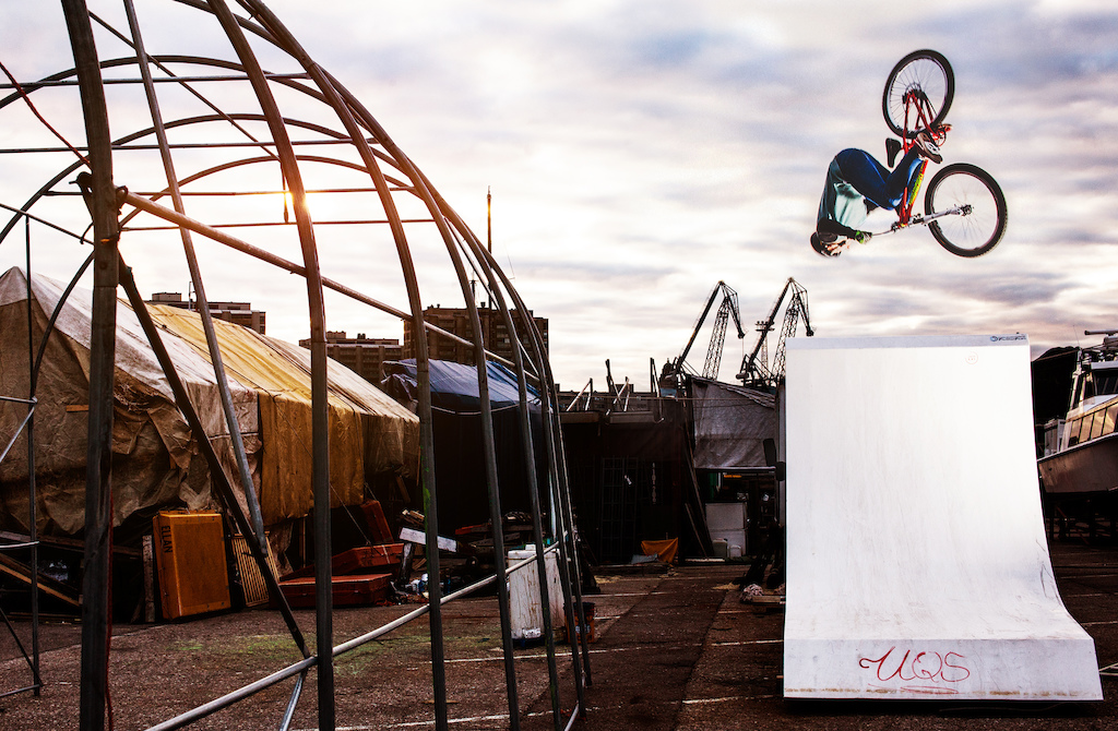 This plastic wakeboarding quarterpipe was serving bike riders during the off season. Antti stomping a flair here during the sunset while Teemu Lautamies Creative captured the action!