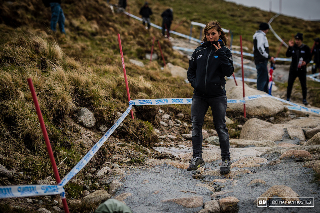 Last year s champ and the series leader Emmeline Ragot walks the rocks and gestures a small variation on the international hand signal for peace.
