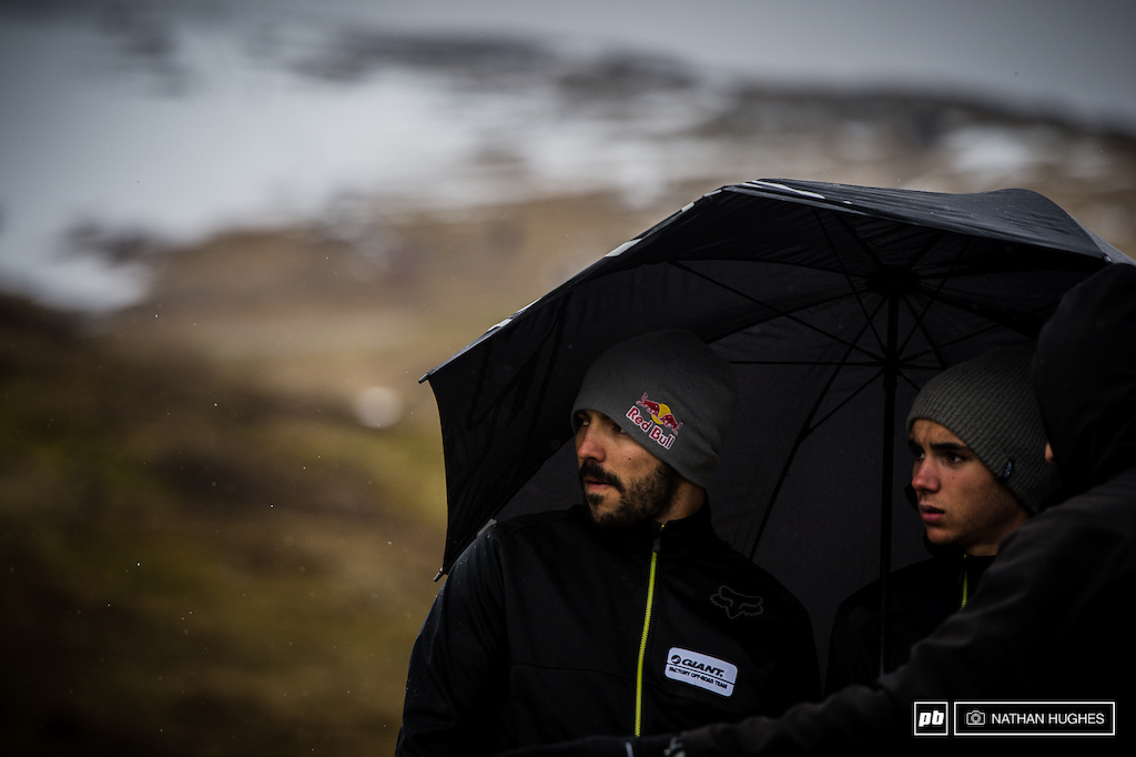 Giant Factory Racing s Marcello Gutierrez and Alex Marin scope under shelter high up on the moor.