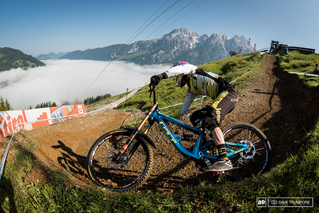 Rachel Atherton rails the first turn out of the gate high above the inversion layer of clouds in the valley below.