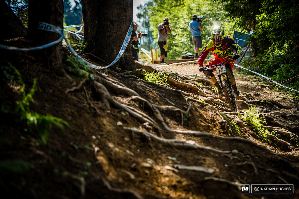 The off-camber roots into the last woods are where riders find out just how comfortable they are outside of their comfort zones with plenty of buck-wild action. Dean Lucas tames the beast.