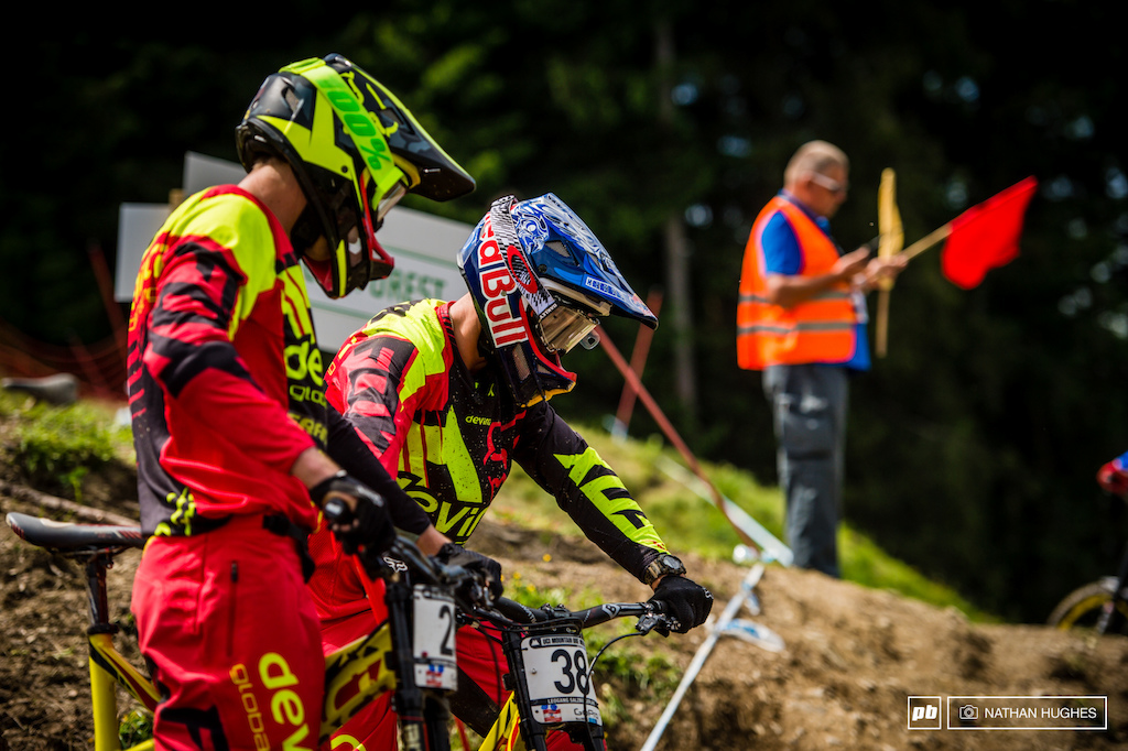 On a red flag, Smith and Wallace scope the upper loam section where riders continue to chop and change lines as the track erodes.