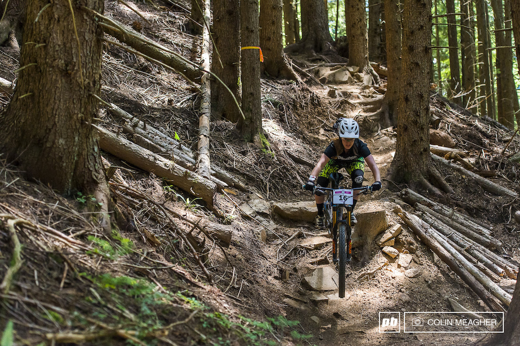 LA Woman Liz Miller pushing her Pivot Mach 6 through the rocks and roots of stage 4.