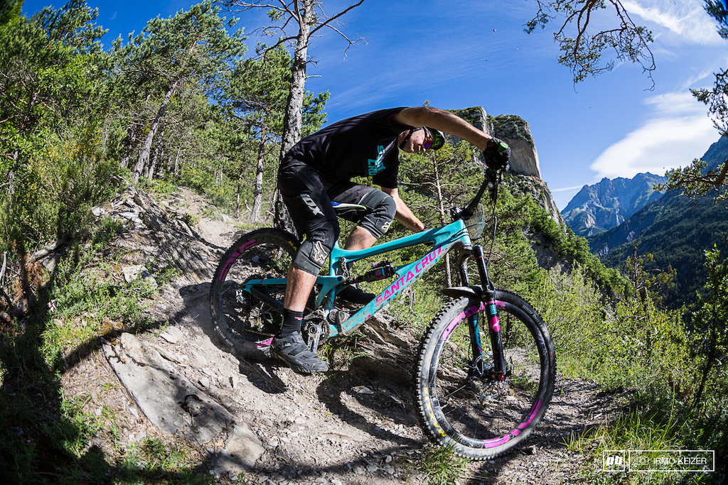 Photographer Gary Perkin exits a steep section of trail. Overshoot this corner and you will have a very slim chance of survival