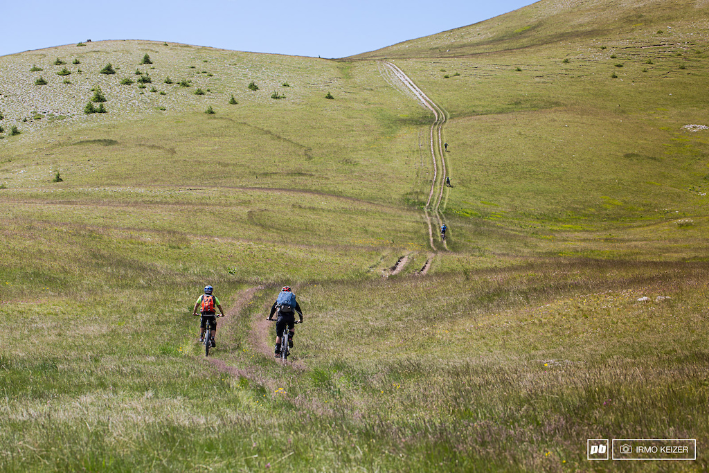 Never make the mistake of thinking the climb is finished. Rounding the corner these riders face another fierce uphill after hours of sustained climbing by bike and on foot.
