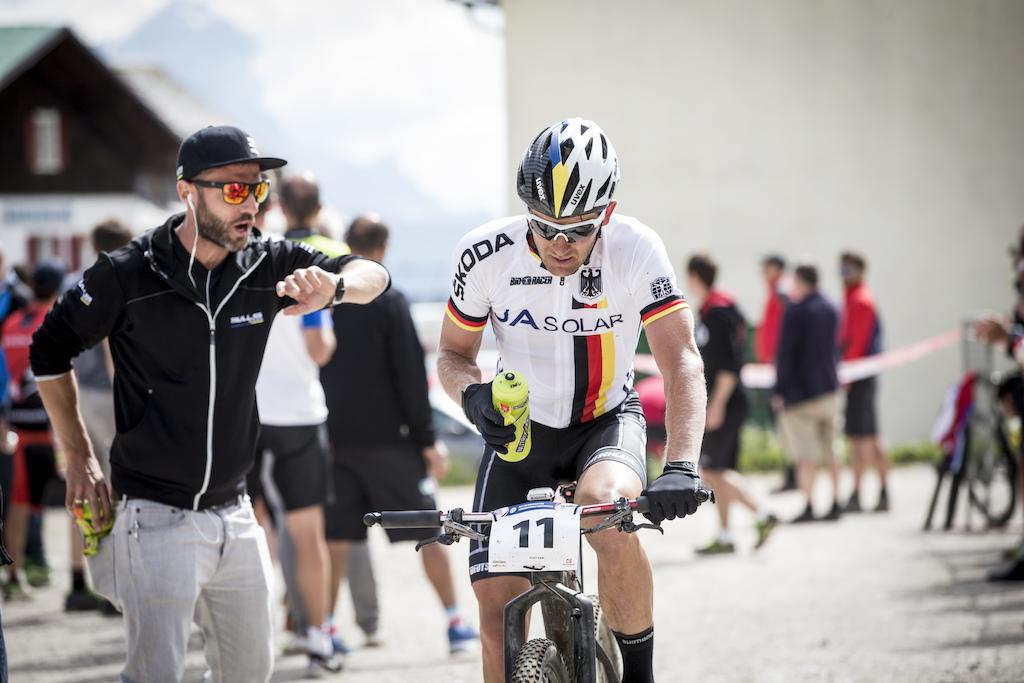 It s not too late dude German s marathon hero Karl Platt gets motivated by his team mechanic Friedemann Schmude.