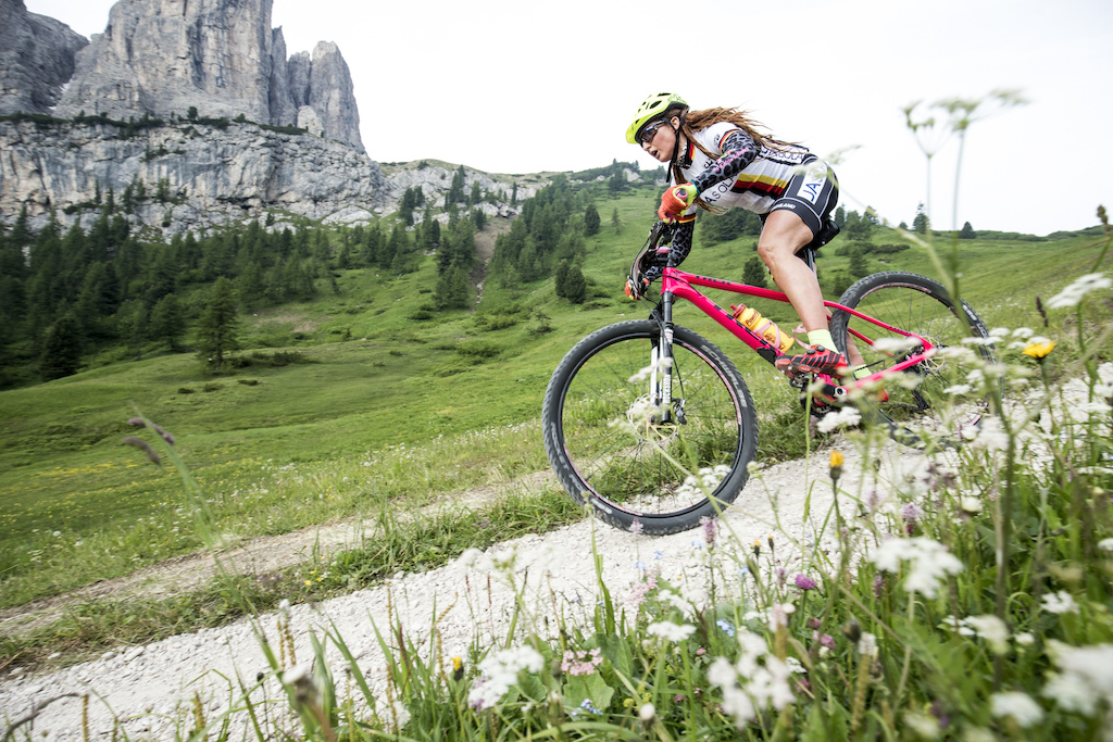 German s colourful marathon pro lady Katrin Schwing on her descent to Corvara.