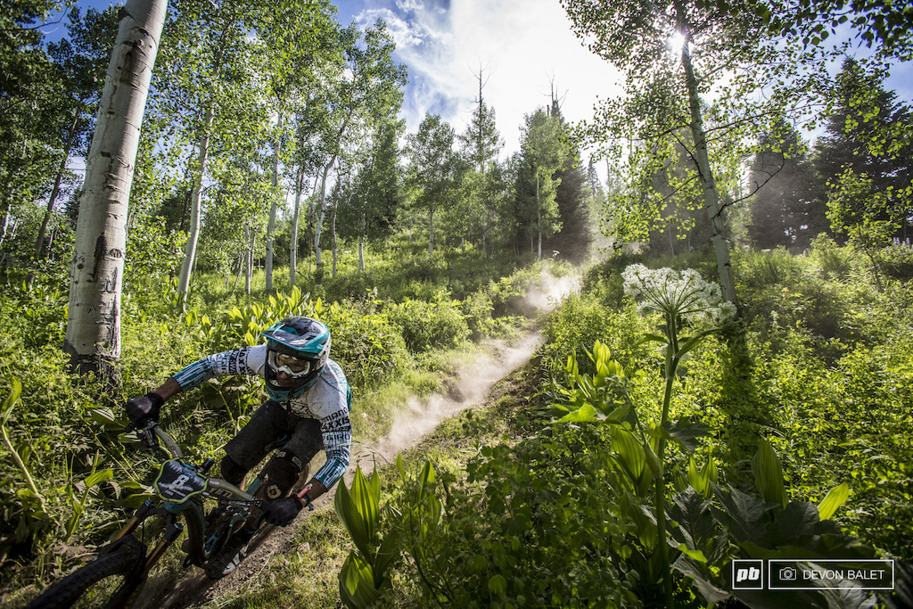 Mike West blazes through the trees on Bonsai DH course. A rough go on stage four forced West out of the top ten for the weekend.