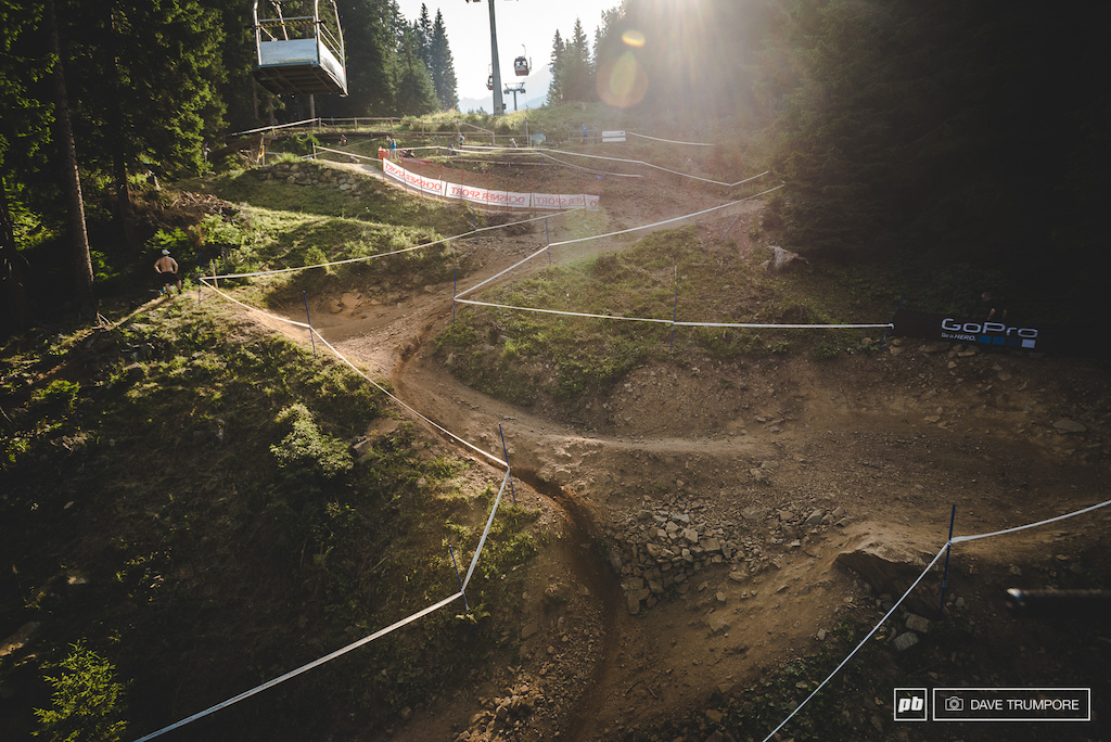 Lots of big bike park berms on offer but the smart line is to go as straight as possible on the inside.