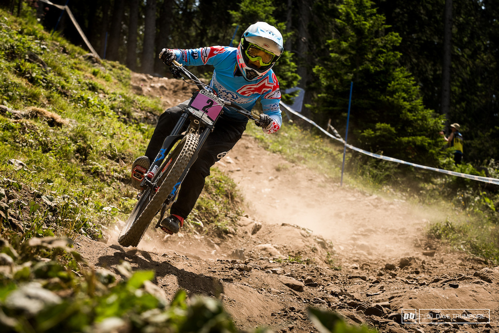 In contrast to Rachel's quali run, Emmeline Ragot was riding very aggressive.  She got a bit loose heading into this corner as her body position shows, but would hold it together to set the fastest time of the day